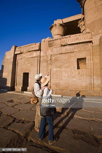 egypt, north of aswan, kom ombo, tourists  looking at temple of kom ombo, side view - aswan stock pictures, royalty-free photos & images
