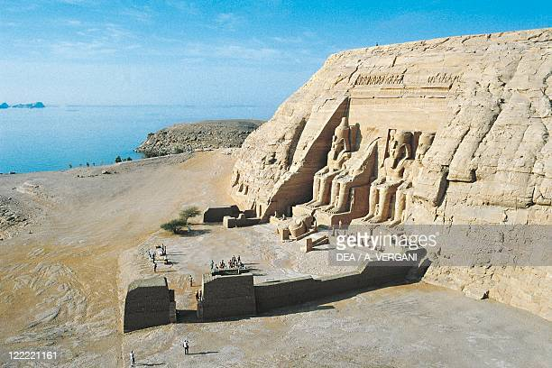 Egypt Nubian monuments at Abu Simbel Great Temple of Ramses II and Lake Nasser in the background