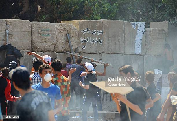 CAIRO Egypt People hurl rocks near the US Embassy in Cairo on Sept 14 to protest a film shot in the United States and regarded as insulting the...