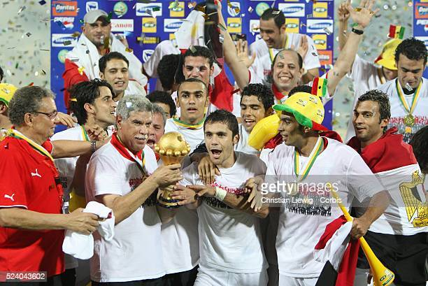 Egypt players and team members celebrating their victory with the trophy during the Final of the CAF African Cup of Nations played between Egypt and...