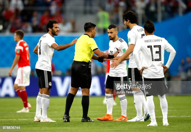 Egypt players argue with Referee Enrique Caceres following Russia's first goal during the 2018 FIFA World Cup Russia group A match between Russia and...