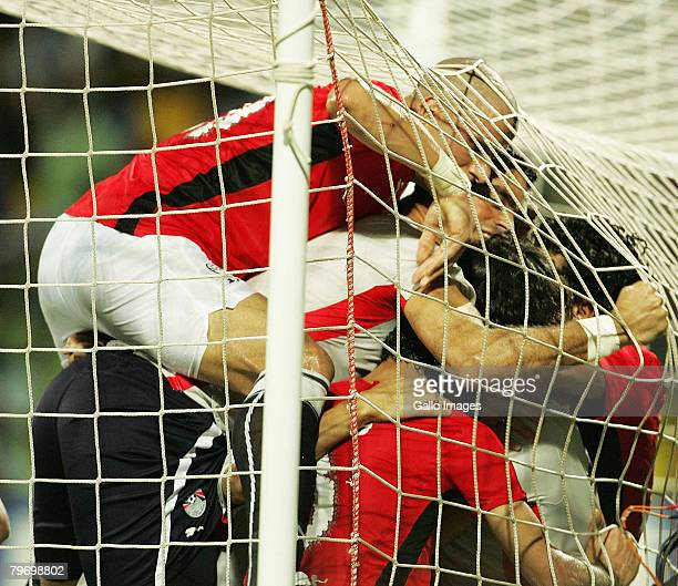 Egypt players celebrate Mohamed Aboutriaka's goal during the AFCON Final match between Cameroon and Egypt at the Ohene Djan Stadium in Accra Ghana