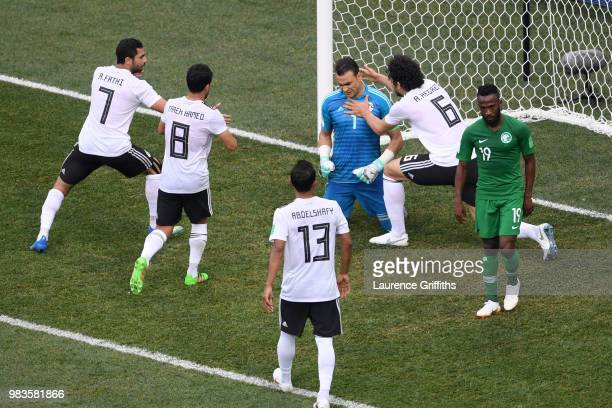 Egypt players congratulate Essam El Hadary of Egypt after he saves a penalty during the 2018 FIFA World Cup Russia group A match between Saudia...