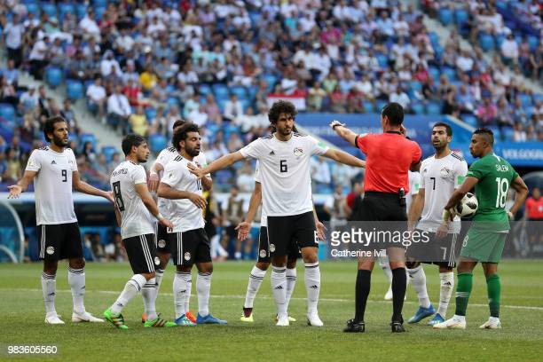 Egypt players react after referee Wilmar Roldan awards Saudi Arabia a penalty during the 2018 FIFA World Cup Russia group A match between Saudia...