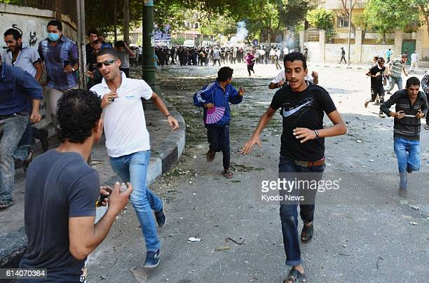 CAIRO Egypt Protesters run away after police officers fired warning shots near the US Embassy in Cairo on Sept 13 as people demonstrate for the third...