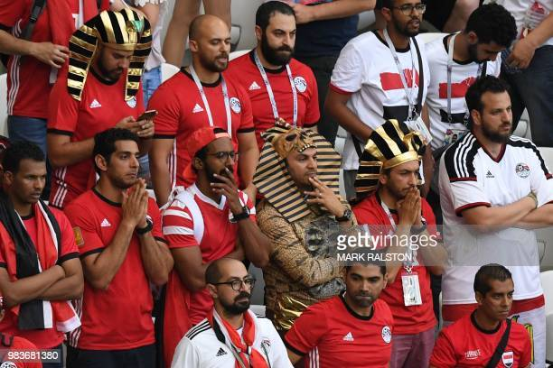Egypt supporters react to their loss during the Russia 2018 World Cup Group A football match between Saudi Arabia and Egypt at the Volgograd Arena in...