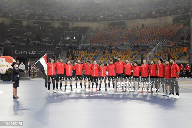 Egypt team poses before the opening match of the 2021 World Men's Handball Championship between Group G teams Egypt and Chile at the Cairo Stadium...