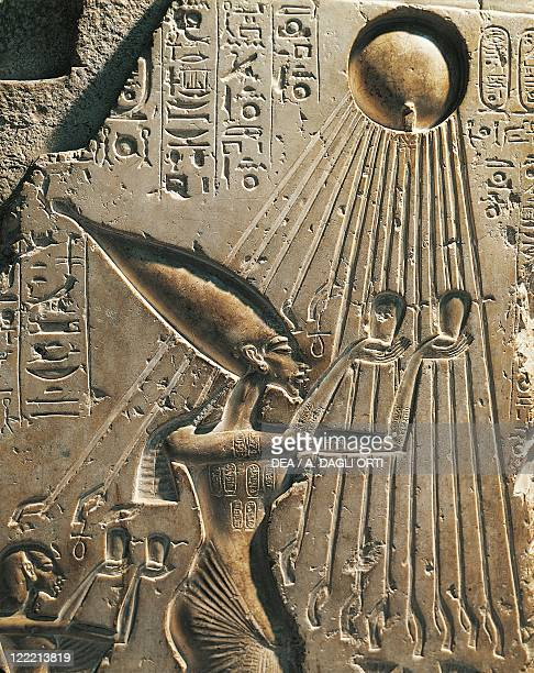 Egypt Tell elAmarna Basrelief depicting Amenhotep IV while worshiping the solar disc eighteenth dynasty New Kingdom limestone