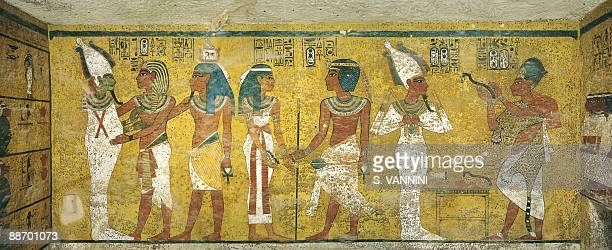 Egypt Thebes Luxor Valley of the Kings Tomb of Tutankhamen Burial chamber Northern wall Mural paintings Pharaoh and ka meet Osiris pharaoh and Nut...