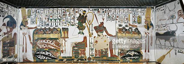 Egypt Thebes Luxor Valley of the Queens Tomb of Nefertari Chamber 2 Mural paintings Queen holds sekhem sceptre to consecrate table of offerings...