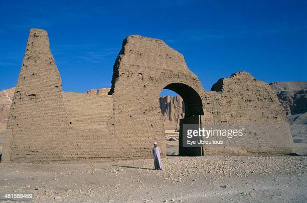 Egypt Upper Egypt Luxor Temple of Hatshepsut entrance gateway with guide and Temple seen through archway