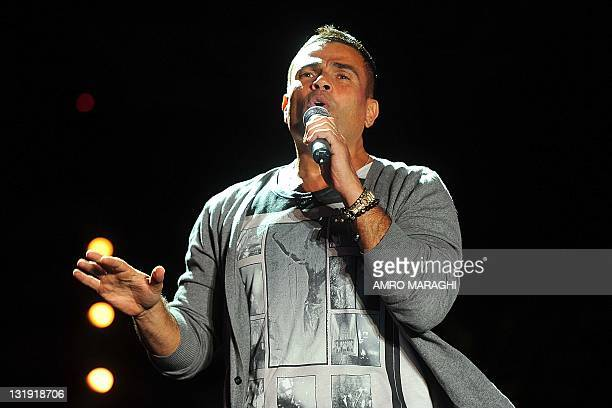 Egyptain pop star Amr Diab is seen performing in the coastal resort of Ain alSukhna east of Cairo late on November 7 2011 AFP PHOTO/AMRO MARAGHI