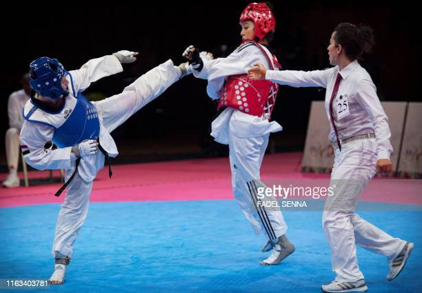 Egypte's Rewan Rafaei Morocco's Safia Salih compete during the Taekwondo women's 57 kg 62 kg finals at the 12th edition of the African Games on...