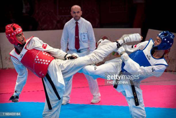 Egypte's Seif Eissa and Tunisia's Firas Katoussi compete during the Taekwondo men's 68 kg 74 kg finals at the 12th edition of the African Games on...