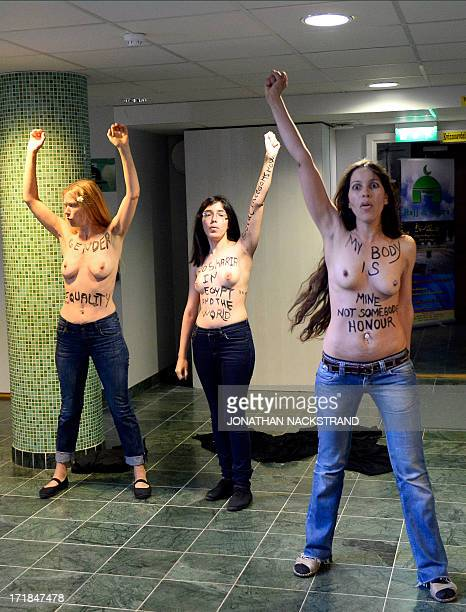 Egyptian activist Aliaa Elmahdy and other members of feminist group FEMEN stage a topless protest for women's rights and against the islamic...
