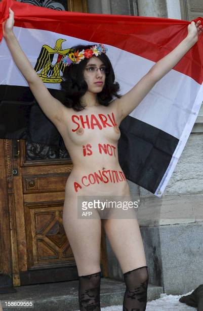 Egyptian activist Aliaa Elmahdy holds an Egyptian flag as she is naked while demonstrating with members from Ukrainian feminist group Femen against...