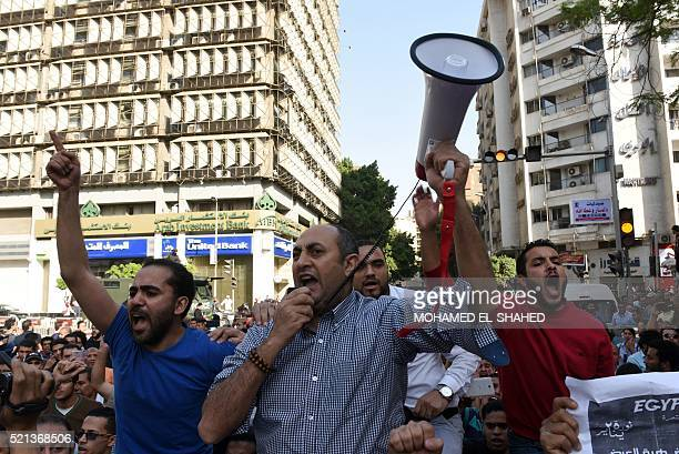 Egyptian activist and lawyer Khaled Ali uses a megaphone to shout slogans during a demonstration against a controversial deal to hand two islands in...
