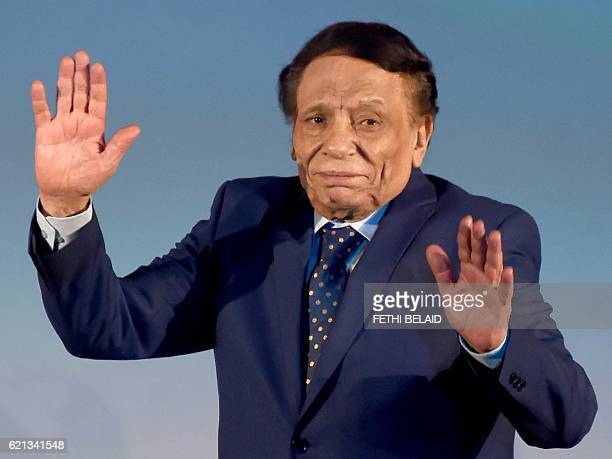Egyptian actor Adel Imam waves from stage during the closing ceremony of the 27th Carthage Film Festival on November 5 in the Tunisian capital Tunis...