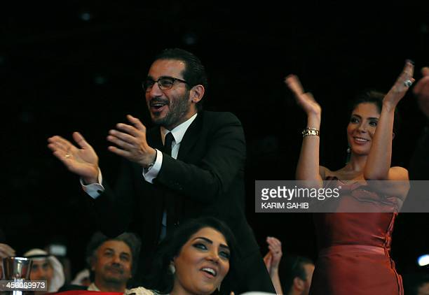 Egyptian actor Ahmed Helmi and his wife actress Mona Zaki clap as they attend the closing ceremony of the 10th Annual Dubai International Film...