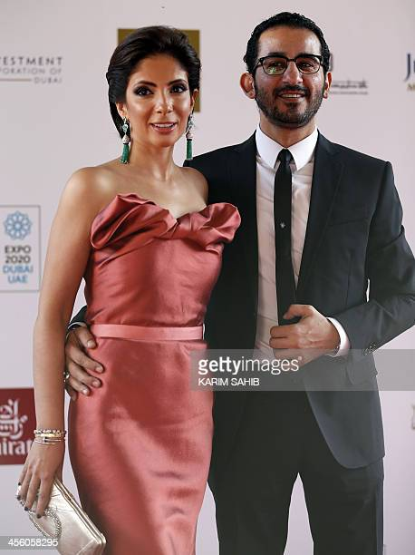 Egyptian actor Ahmed Helmi posses for a photograph with his wife actress Mona Zaki as they attend the closing ceremony of the 10th Annual Dubai...
