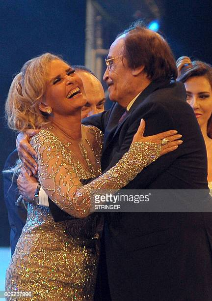 Egyptian actor Ezzat elAlayli and Egyptian film star Yusra react on stage during the opening ceremony of the 32nd Alexandria film festival in Egypt's...