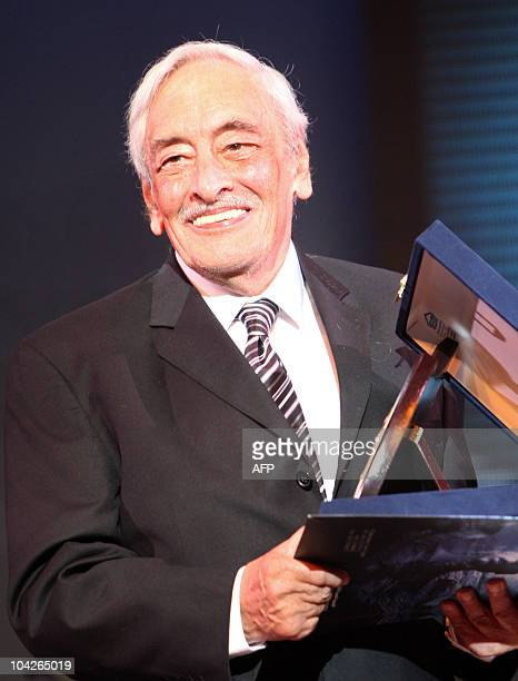 Egyptian actor Gamal Rateb holds his honorary award during the opening ceremony of the Alexandria Film Festival for Mediterranean Countries in the...