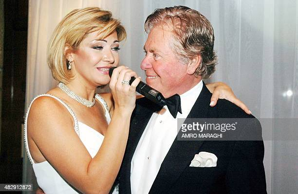 Egyptian actor Hussein Fahmi looks at his bride Egyptian actress Liqa Sweidan as she sings during their wedding ceremony in Cairo 29 December 2007...