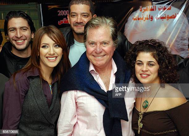 Egyptian actor Hussein Fahmi poses with new actresses Hiba Abdul Aziz and Mona Hala during a press conference for the new film 'Lamh alBasar' in...