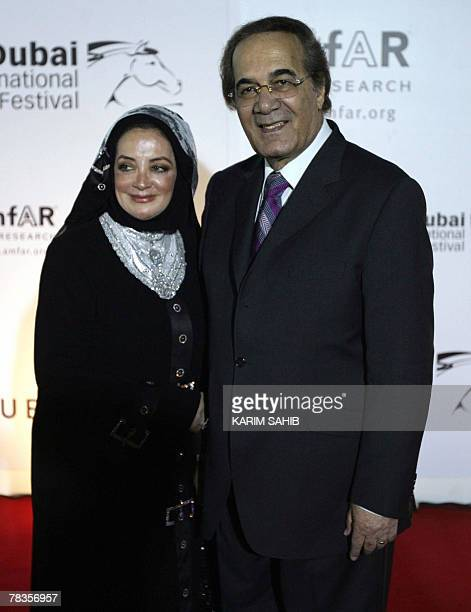 Egyptian actor Mahmud Yassin and his wife Shahira arrive at the Cinema Against AIDS event held in association with the 4th Dubai International Film...