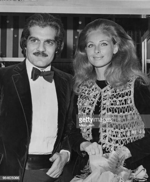 Egyptian actor Omar Sharif and Swedish actress Camilla Sparv arrive for the premiere of the film 'Mackenna's Gold' at the Odeon Leicester Square...