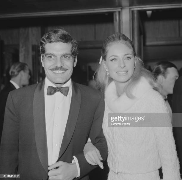Egyptian actor Omar Sharif and Swedish actress Camilla Sparv arrive at the world premiere of the film 'The Night of the Generals' in London 27th...