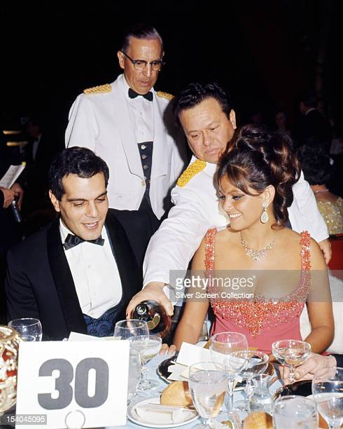 Egyptian actor Omar Sharif dining with Italian actress Claudia Cardinale at the Golden Globe Awards at the Cocoanut Grove nightclub Los Angeles 28th...