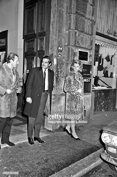 Egyptian actor Omar Sharif known as Omar ElSherif and born Michel Demitri Shalhoub going out of the front door of a building in Via Condotti along...