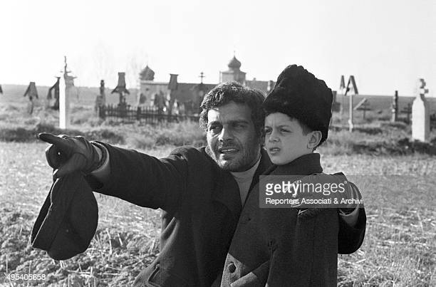 Egyptian actor Omar Sharif showing something to his son Tarek Sharif on the set of of the film Doctor Zhivago 1965