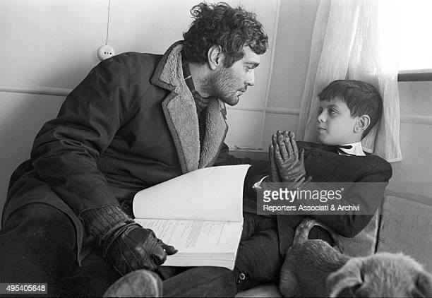 Egyptian actor Omar Sharif studying the plot of the film Doctor Zhivago with his son Tarek Sharif 1965
