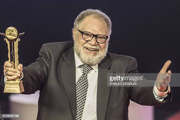Egyptian actor Yahya elFakharani poses on stage after receiving an honorary award during the closing ceremony of the 38th Cairo International Film...