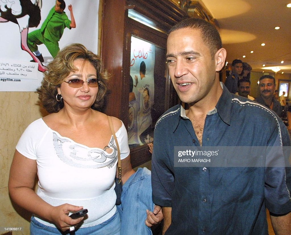 Egyptian actors Ashraf Abdel Baki and Laila Elwi walk through a movie  theatre late 07 August