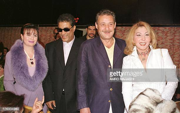 Egyptian actors Elham Shahine Ahmed Zaki Farouk alFishawi and Nadia alGhindi attend the premiere of Nadia's new film 'alRaghba' 20 February 2002 in...