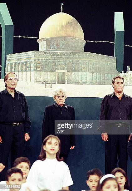 Egyptian actors Mahmoud Yassin Nadia Lutfi and Farouk alFishawi participate in performing a song 20 October 2000 dedicated for alAqsa uprising and...