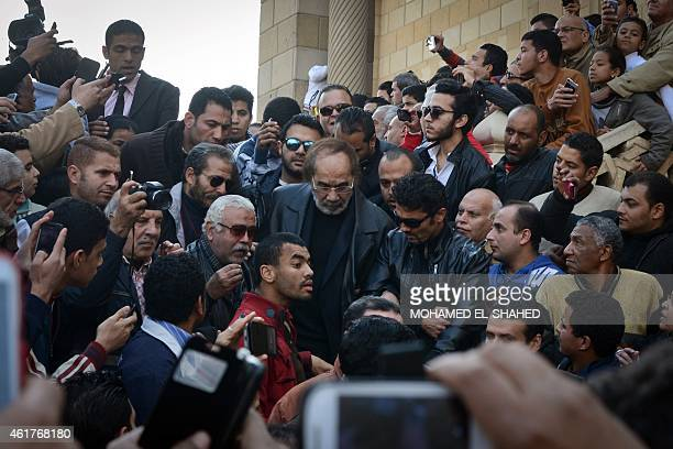 Egyptian actors Mahmud Yassin and Khaled alNabawi attend the funeral of Egypt's veteran actress Faten Hamama on January 18 2015 at a mosque on the...