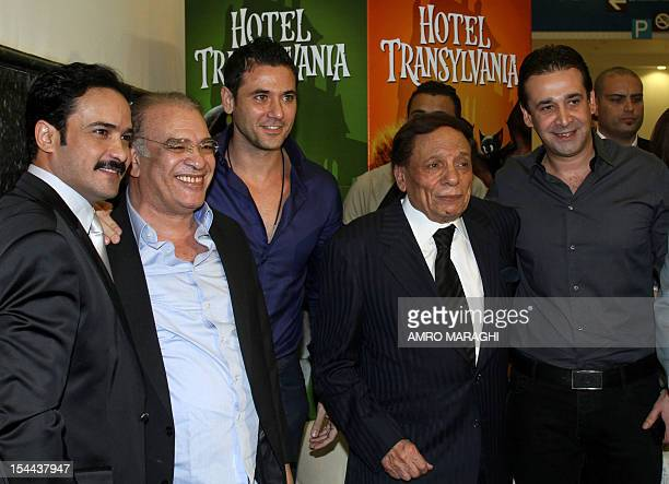 Egyptian actors Mohammed Ragab Salah Abdullah Ahmed Ezz Adel Imam and Karim Abdul Aziz attend the opening ceremony of a new cinema complex in 6th of...