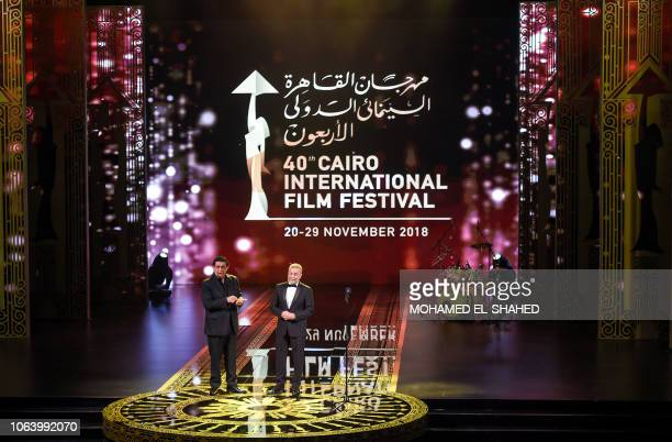 Egyptian actors Sherif Mounir and Maged El-Kedwani speak while presenting during the opening ceremony of the 40th edition of the Cairo International...