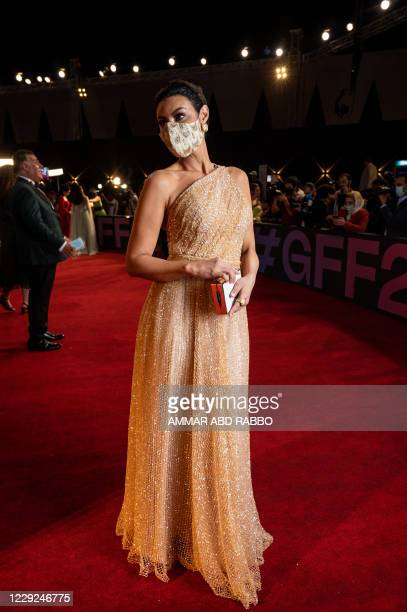 Egyptian actress Arwa Gouda arrives at the opening ceremony of the 4th edition of El Gouna Film Festival in the Egyptian Red Sea resort of el Gouna...