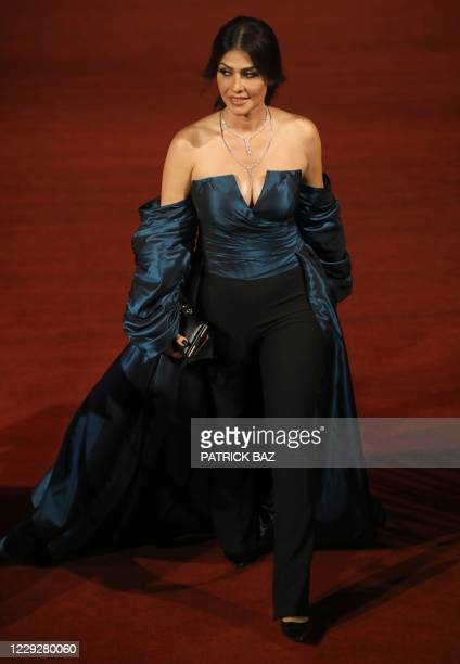 Egyptian actress Basma Hassan walks the red carpet of the 4th edition of the Gouna Film Festival at the Red Sea resort of El-Gouna on October 25,...