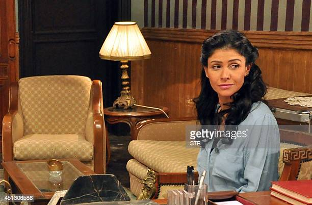 Egyptian actress Basma is pictured on April 10 2014 during the shooting in Cairo of one of the episodes of 'Ahl Alexandria' a television soap opera...