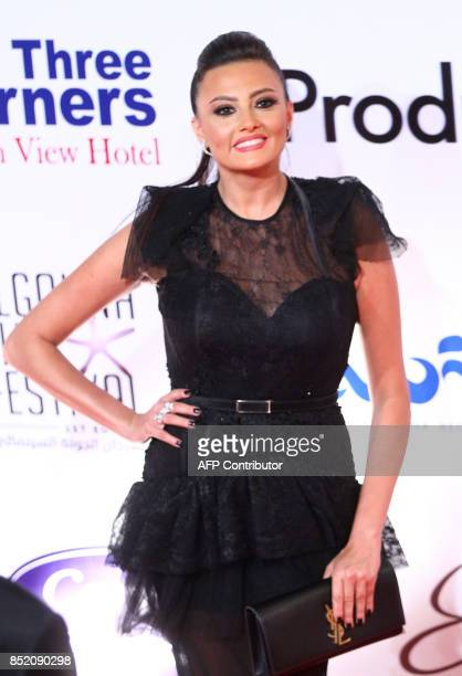 Egyptian actress Bushra poses for photos during the opening ceremony of the first edition of the ElGouna Film Festival in Hurghada late on September...
