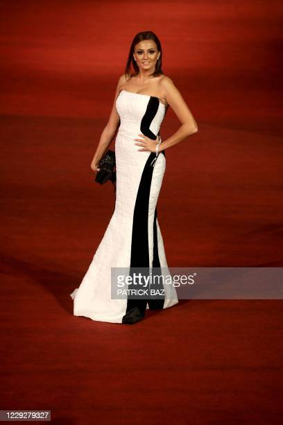 Egyptian actress Bushra Rozza walks the red carpet of the 4th edition of the Gouna Film Festival at the Red Sea resort of El-Gouna on October 25,...