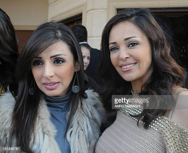"""Egyptian actress Dalia alBiheri and singer Angham pose for the camera after a press conference about their new television series """"Fee Gamdat Aaen""""..."""