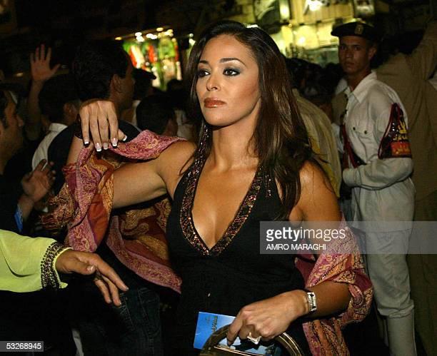Egyptian actress Dalia elBeheri arrives at the premier of Adel Imam's new movie 'ElSafarah fi ElAmarah' late 19 July 2005 in Cairo AFP PHOTO/AMRO...