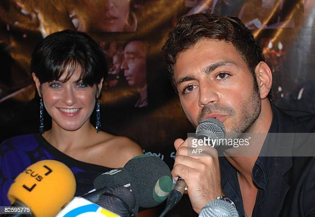 Egyptian Actress Heidi Karam listens to Lebanese Singer Ewan as he speaks to the press in Cairo late 28 August 2008 The press conference was held to...